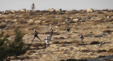 2011-07-18 settlers from Havat Ma'on attack internationals in Meshakha hill